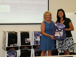 Cupertino/Sunnyvale District Chair Mary Combes (left) and Michelle Ma are pictured here with 48 backpacks donated to West Valley Community Services to be distributed to low-income students at the beginning of the school year.