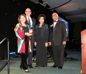 The Silicon Valley Association of REALTORS® (SILVAR) received the platinum award from the National Association of REALTORS® for its global council program at the 2013 REALTORS® Conference & Expo in San Francisco. Pictured here are (left to right) SILVAR president Carolyn Miller and executive officer Paul Cardus, who received the award from Nancy Suvarnamani and Furhad Waquad, 2014 and 2013 chair, respectively, of the NAR Global Business and Alliances Committee.