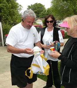 SILVAR President David Tonna and Diane Chandler hand a senior homeowner a complimentary RSVP (REALTOR® Service Volunteer Program) bag, which includes batteries, face mask to protect them from harsh chemicals, and a vial of life, so they can have their complete medical information ready in their home for emergency personnel to reference during an emergency.