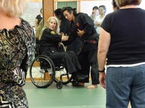 Karen Trolan demonstrates a move that can knock down an assailant.