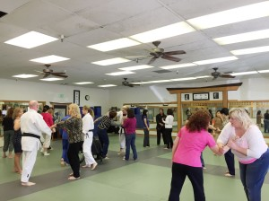 Real estate professionals practice some self-defense moves.
